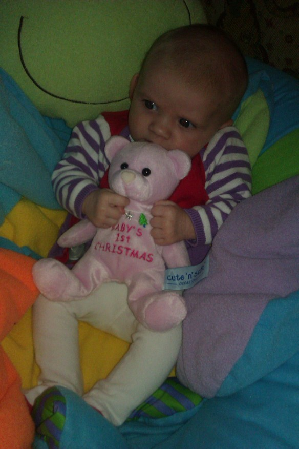 Little Miss A with her first ever present from Santa