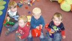 Little Mr A with some of his toddler group friends