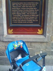 Little Mr A underneath the plaque on the pub his great, great grandad owned in St Andrews