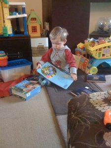 Little Mr A reading and playing